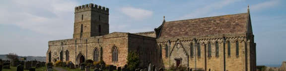 12th c. Bamburgh Church built over the site of Aidan's 635 AD wooden church. There is a wooden beam in the church that is believed to be the beam that Aidan laid against as he died