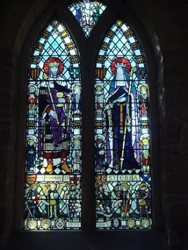 Stained Glass of St. Aebba at St. Ebba's Church, Beadnell. Designed by Joseph Nyutgens