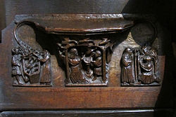 Carving of St. Werburga with the flock of geese on the misericord in Chester Cathedral